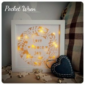 Make Your Own Paper Cut Festive Light Up Wreath with Pocket Wren